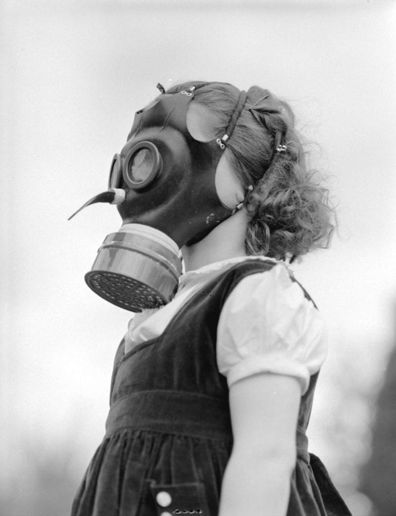 toddler with gas mask