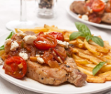 pork chop with tomato and feta